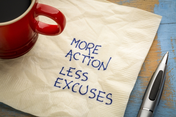 More action, less excuses - handwriting on a napkin with a cup o